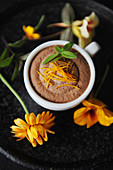 Chocolate terrine in a cup decorated with yellow flowers