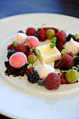Raspberry sorbet with white chocolate and fresh berries