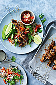 Thai beef skewers with rice and quinoa salad