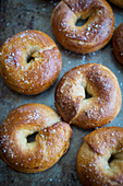 Crisp bagels with sea salt on a baking tray
