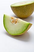 A half and a quarter of a honeydew melon