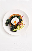 Poached egg with wilted kale and avocado