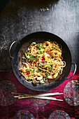 Spiced longevity noodles with coriander and prawns (China)