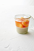 Burnt honey panna cotta with poached nectarines