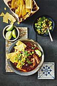 Pork mole stoup with avocado salsa
