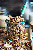 Amaranth and nutbutter granola with dried fruit in a jar (vegan)