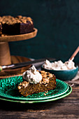 A slice of freekeh pumpkin cake with coconut and espresso cream (vegan)