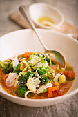 Minestrone with vegetables in a soup bowl