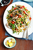 Lentil and spinach salad with smoked mackerel, prunes and cherry tomatoes