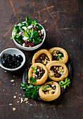 Puff pastry tarts with tomato and cheese