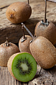 Organic kiwis, whole and halved