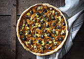 Vegan quiche with grated sweet potatoes, purple Brussels and cheese substitute