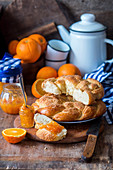 Homemade orange wreath bread with marmalade