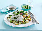 Baked herby cod with watercress and bean salad