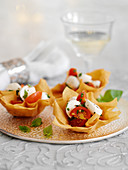 Tartlets with mozzarella and tomatoes