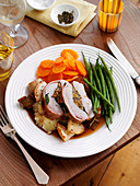 Roast pork with vegetables and potatoes