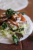 A wrap with chicken and kale