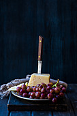 Ripe cheddar with red grapes