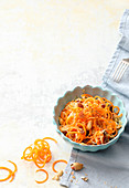 Raw carrot spaghetti with sauerkraut and peanuts