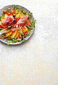 Peach and nectarine salad with ham and capers