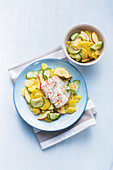 Steamed cod with potato and cucumber salad