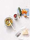 Zutaten für Quinoa-Minestrone mit Zucchini und Pesto