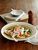 Vegetable soup with chicken and a poached egg