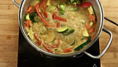 Yellow vegetable curry being made
