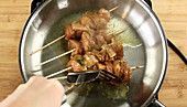 Grilled chicken skewers being prepared
