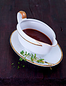 Thyme jus in a gravy boat