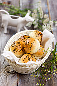 Bread rolls with black sesame seeds in a bread basket