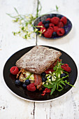 Sandwich with rucola and raspberries