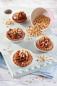Cupcakes filled with toffee with crushed peanuts