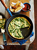 Asparagus frittata with potato wedges