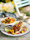 Grilled swordfish steaks with red pepper and mango salsa