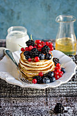 Pancakes with berry fruits, yogurt and agave syrup
