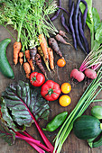 Freshly harvested vegetables from a garden (colourful vegetables, beetroot, cucumber, courgettes, chard, tomatoes and beans)