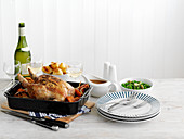 Roast turkey with various side dishes and glasses of wine