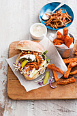 A pork sandwich and sweet potato fries