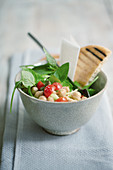 Chickpea salad with tomatoes, basil and unleavened bread