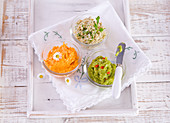 Carrot butter, guacamole and parsley-freekeh spread