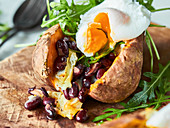 Stuffed sweet potato with rocket and poached egg