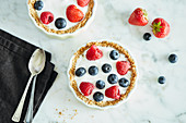 Breakfast tarts with granola, yoghurt and berries