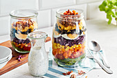 Rainbow layered salad in jars with a buttermilk dressing