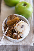 Apple and pear crumble with a scoop of ice cream