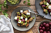 Bread salad with beetroot, sheep's cheese and smoked almond pesto