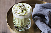 A glass of matcha latte