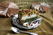 A slice of spinach cake with pomegranate seeds