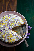 Lemon cake with vanilla cream and lilac blossoms