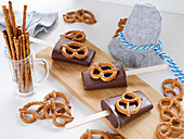 Cool dogs (ice cream) on sticks with salt pretzels
